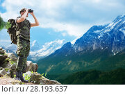 Купить «soldier with backpack looking to binocular», фото № 28193637, снято 14 августа 2014 г. (c) Syda Productions / Фотобанк Лори