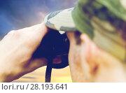 Купить «close up of soldier looking to binocular», фото № 28193641, снято 14 августа 2014 г. (c) Syda Productions / Фотобанк Лори