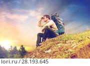 Купить «traveler with backpack hiking over sky background», фото № 28193645, снято 31 августа 2014 г. (c) Syda Productions / Фотобанк Лори