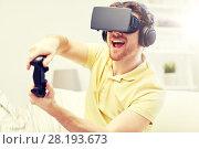 Купить «man in virtual reality headset with controller», фото № 28193673, снято 12 марта 2016 г. (c) Syda Productions / Фотобанк Лори