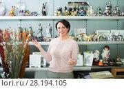 Купить «Mature woman near souvenirs shelves», фото № 28194105, снято 24 марта 2019 г. (c) Яков Филимонов / Фотобанк Лори