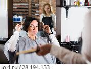 Купить «Upset woman in hairdress salon», фото № 28194133, снято 7 марта 2017 г. (c) Яков Филимонов / Фотобанк Лори