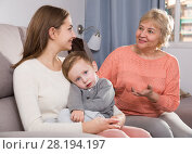 Купить «Aged woman is sharing her experience with daughter for upbringing toddler», фото № 28194197, снято 15 февраля 2018 г. (c) Яков Филимонов / Фотобанк Лори