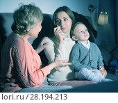 Купить «Aged woman is comforting emotional daughter after watching film», фото № 28194213, снято 15 февраля 2018 г. (c) Яков Филимонов / Фотобанк Лори