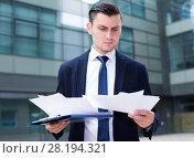 Director is examining documents before signing. Стоковое фото, фотограф Яков Филимонов / Фотобанк Лори