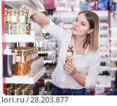 Купить «Girl customer choosing for stylish fragrance of perfume», фото № 28203877, снято 31 января 2018 г. (c) Яков Филимонов / Фотобанк Лори
