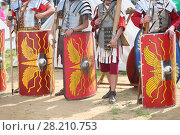 Купить «MOSCOW - JUN 06, 2015: Equipment and weapons of the Roman soldiers at the festival Times and epoch: Ancient Rome in Kolomenskoye», фото № 28210753, снято 6 июня 2015 г. (c) Losevsky Pavel / Фотобанк Лори