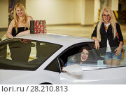 Купить «Three laughing women, one sits on driver seat and another two stand near modern white car at underground parking», фото № 28210813, снято 2 июня 2016 г. (c) Losevsky Pavel / Фотобанк Лори
