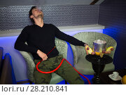 Купить «Man in khaki pants exhale smoke in smoky room», фото № 28210841, снято 22 апреля 2015 г. (c) Losevsky Pavel / Фотобанк Лори