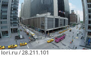 Купить «NEW-YORK - AUG 23, 2014: Hilton Midtown Manhattan Hotel on Avenue of the Americas with traffic at summer day. Aerial view. Hilton has more than 540 locations in 78 countries.», фото № 28211101, снято 23 августа 2014 г. (c) Losevsky Pavel / Фотобанк Лори