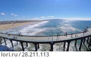 Купить «MANHATTAN BEACH - NOV 02, 2014: Manhattan Beach Pier with several people at sunny day. Aerial view. The pier is 283 meters long.», фото № 28211113, снято 2 ноября 2014 г. (c) Losevsky Pavel / Фотобанк Лори