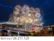 Crowd on Palace Bridge look at grandiose fireworks at night in St. Petersburg, Russia. I have only one version of the photo with sharpening (2014 год). Стоковое фото, фотограф Losevsky Pavel / Фотобанк Лори