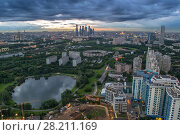 Купить «Panoramic view of park, pond, residential district in Moscow, Russia during cloudy summer day. I have only one version of the photo with sharpening», фото № 28211169, снято 25 июня 2014 г. (c) Losevsky Pavel / Фотобанк Лори