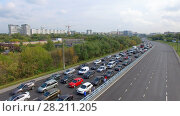 MOSCOW - SEP 06, 2015: Long traffic jam on highway during bicycle parade at autumn day. Aerial view videoframe. Редакционное фото, фотограф Losevsky Pavel / Фотобанк Лори
