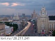Купить «MOSCOW - MAY 23, 2016: Garden ring, Beijing Hotel, Theatre of Satire, Stalin skyscraper on Kudrinskaya Square at dusk», фото № 28211241, снято 23 мая 2016 г. (c) Losevsky Pavel / Фотобанк Лори