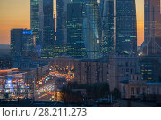 Купить «MOSCOW, RUSSIA - AUG 24, 2015: Road and skyscrapers in Moscow City business complex including area of business activity», фото № 28211273, снято 24 августа 2015 г. (c) Losevsky Pavel / Фотобанк Лори