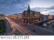 Купить «ST. PETERSBURG, RUSSIA - JUL 20, 2015: Singer building with illumination, Nevsky avenue at evening, Singer building was built in 1902-1904», фото № 28211293, снято 20 июля 2015 г. (c) Losevsky Pavel / Фотобанк Лори