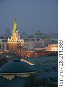 Купить «Troitskaya Tower and State Kremlin Palace with illimination at night in Moscow, Russia», фото № 28211389, снято 25 июля 2016 г. (c) Losevsky Pavel / Фотобанк Лори