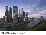 Купить «MOSCOW - OCT 06, 2015: Moscow International Business Center at summer. Investments in Moscow International Business Center was approximately 12 billion dollars», фото № 28211397, снято 6 октября 2015 г. (c) Losevsky Pavel / Фотобанк Лори