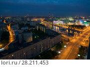 Купить «Bridge of Bogdan Khmelnitsky and Borodinsky bridge in Moscow, Russia at night», фото № 28211453, снято 11 июня 2016 г. (c) Losevsky Pavel / Фотобанк Лори