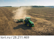 Купить «KRASNODAR REGION, RUSSIA - AUG 19, 2015: Modern tractor plow field, In 2015 in Krasnodar region have collected record grain harvest - 102 million tons of grain», фото № 28211469, снято 19 августа 2015 г. (c) Losevsky Pavel / Фотобанк Лори