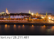 Купить «Bell tower of Ivan Great, Kremlin wall, Cathedral of St. Basil, Moskva river at evening in Moscow», фото № 28211481, снято 14 декабря 2014 г. (c) Losevsky Pavel / Фотобанк Лори