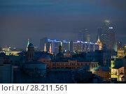 Купить «Stars on Kremlin towers, skyscrapers and buildings of New Arbat Street in center of Moscow, Russia at night», фото № 28211561, снято 31 мая 2015 г. (c) Losevsky Pavel / Фотобанк Лори