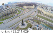 Купить «MOSCOW - APR 21, 2015: Megapolis with street traffic near monument of First Man in Space Yuriy Gagarin at spring sunny day. Aerial view video frame», фото № 28211629, снято 21 апреля 2015 г. (c) Losevsky Pavel / Фотобанк Лори