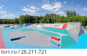 Купить «MOSCOW - JUN 18, 2015: Skate park Megadrome Ostankino with colourful area at summer sunny day. Aerial view videoframe», фото № 28211721, снято 18 июня 2015 г. (c) Losevsky Pavel / Фотобанк Лори
