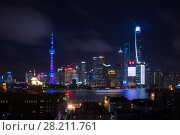 Купить «SHANGHAI - AUG 11, 2015: TV tower Oriental Pearl with illumination at night, Tower third highest in Asia», фото № 28211761, снято 11 августа 2015 г. (c) Losevsky Pavel / Фотобанк Лори