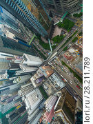 Купить «Skyscrapers, office buildings, road in Hong Kong city, China at sunny day, top view from China Resources Building», фото № 28211789, снято 1 сентября 2015 г. (c) Losevsky Pavel / Фотобанк Лори