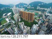 Купить «High skyscrapers, office buildings and green mountains in Hong Kong city, China, aerial view from Manulife Plaza», фото № 28211797, снято 1 сентября 2015 г. (c) Losevsky Pavel / Фотобанк Лори