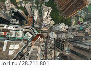 Купить «High skyscrapers, buildings roofs and roofer in Hong Kong city, China, aerial view from Manulife Plaza», фото № 28211801, снято 1 сентября 2015 г. (c) Losevsky Pavel / Фотобанк Лори