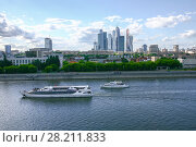 Купить «Two ships sail on river at summer day in Moscow, Russia, Skyscrapers far away», фото № 28211833, снято 6 июня 2015 г. (c) Losevsky Pavel / Фотобанк Лори