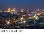 Купить «MOSCOW - APR 8, 2016: Kievsky railway station at night. Russian Railways is among three largest transport companies in world», фото № 28211881, снято 8 апреля 2016 г. (c) Losevsky Pavel / Фотобанк Лори