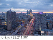 Купить «New Arbat Street, highway with moving cars, skyscrapers at evening in Moscow, Russia», фото № 28211901, снято 5 апреля 2015 г. (c) Losevsky Pavel / Фотобанк Лори