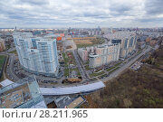 Купить «Residential area with buildings and construction site at spring day in Moscow, Russia», фото № 28211965, снято 21 апреля 2016 г. (c) Losevsky Pavel / Фотобанк Лори