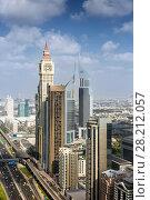 Купить «DUBAI, UAE - JAN 8, 2017: Al Yaqoub Tower, Complex Emirates Towers, Al Yaqoub Tower is 328 m skyscraper on Sheikh Zayed Road. The tower topped out in 2010.», фото № 28212057, снято 8 января 2017 г. (c) Losevsky Pavel / Фотобанк Лори