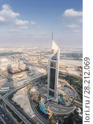 Купить «DUBAI, UAE - JAN 8, 2017: Jumeirah Emirates Towers Hotel, At structural height of 309 m», фото № 28212069, снято 8 января 2017 г. (c) Losevsky Pavel / Фотобанк Лори