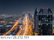 Купить «Sheikh Zaid Highway and many skyscrapers at night, Dubai, United Arab Emirates», фото № 28212101, снято 9 января 2017 г. (c) Losevsky Pavel / Фотобанк Лори