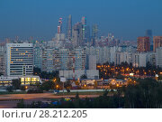 Купить «Sleeping area with illuminated road, tall buildings at night in Moscow, Russia», фото № 28212205, снято 8 июня 2016 г. (c) Losevsky Pavel / Фотобанк Лори
