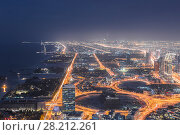 Купить «Skyscrapers and highways with illumination at night in Dubai, Arab Emirates», фото № 28212261, снято 15 января 2017 г. (c) Losevsky Pavel / Фотобанк Лори