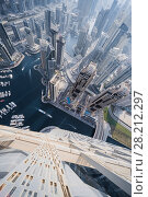 Купить «DUBAI, UAE - JAN 20, 2017: Cayan Tower top view in Dubai Marina area, Cayan is tallest building in world, which is twisted by 90 degrees», фото № 28212297, снято 20 января 2017 г. (c) Losevsky Pavel / Фотобанк Лори