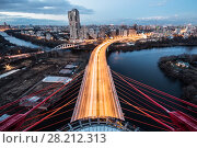 Купить «MOSCOW - APR 18, 2014: (top view) Zhivopisny Bridge. It is first cable-stayed bridge in Moscow, opened on 27 December 2007», фото № 28212313, снято 18 апреля 2014 г. (c) Losevsky Pavel / Фотобанк Лори