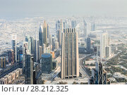 Купить «DUBAI, UAE - JAN 21, 2017: Emirates Financial Tower, Index Building in Business Bay development in Dubai, Gross Domestic Product of UAE - 375 billion dollars», фото № 28212325, снято 21 января 2017 г. (c) Losevsky Pavel / Фотобанк Лори