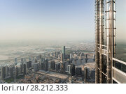Купить «Business Bay, residential area, part of tower and desert far away in Dubai, United Arab Emirates», фото № 28212333, снято 21 января 2017 г. (c) Losevsky Pavel / Фотобанк Лори