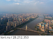 Купить «Bridges ans river at sunny summer day, Guangzhou, China, aerial view», фото № 28212353, снято 21 августа 2015 г. (c) Losevsky Pavel / Фотобанк Лори