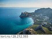 Купить «Beautiful coast of sea with rocks, town and mountains at hot summer day», фото № 28212393, снято 27 августа 2014 г. (c) Losevsky Pavel / Фотобанк Лори