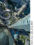 Купить «SHANGHAI - AUG 13, 2015: Top view of Shanghai IFC hotel, It incorporates two tower blocks at 249.9 metres (south tower) and 259.9 metres (north tower)», фото № 28212457, снято 13 августа 2015 г. (c) Losevsky Pavel / Фотобанк Лори