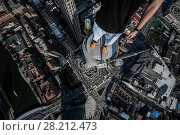 Купить «Legs of rooder standing in tall tower in Tianjin city, China at summer day», фото № 28212473, снято 9 августа 2015 г. (c) Losevsky Pavel / Фотобанк Лори